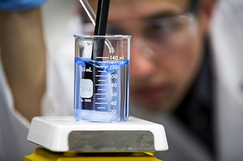 chemist tests drinking water quality